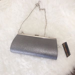 Brand new party clutch with removable strap